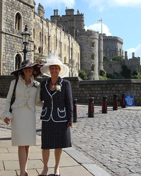 You can tell by the hats - my mother and I are on our way to the Ascot horse races.